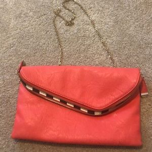 Hot pink clutch with gold chain